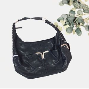 Chunky black leather moto inspired shoulder bag
